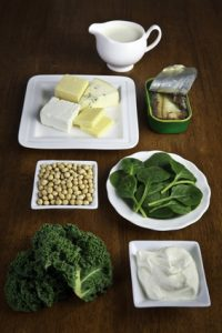 A selection of plant and dairy calcium sources on table