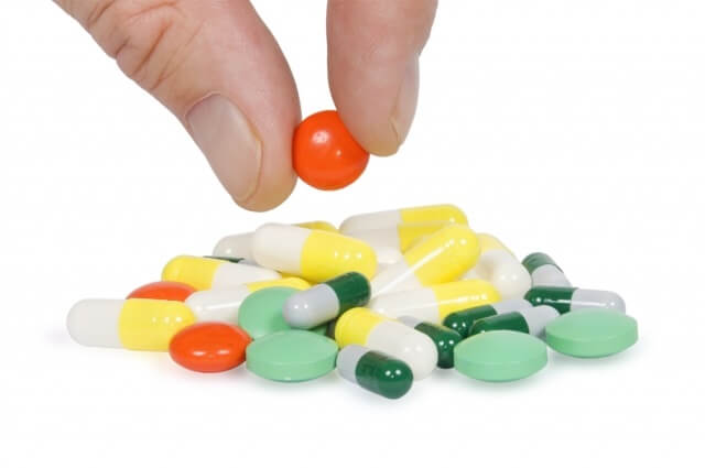 An assortment of colorful pills in a pile