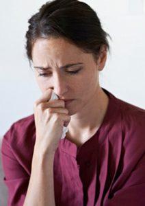 Grieving woman holding handkerchief