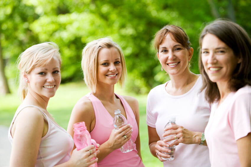 Group of women outdoors running for breast cancer fundraising