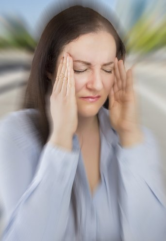 Woman suffering migraine headache attack